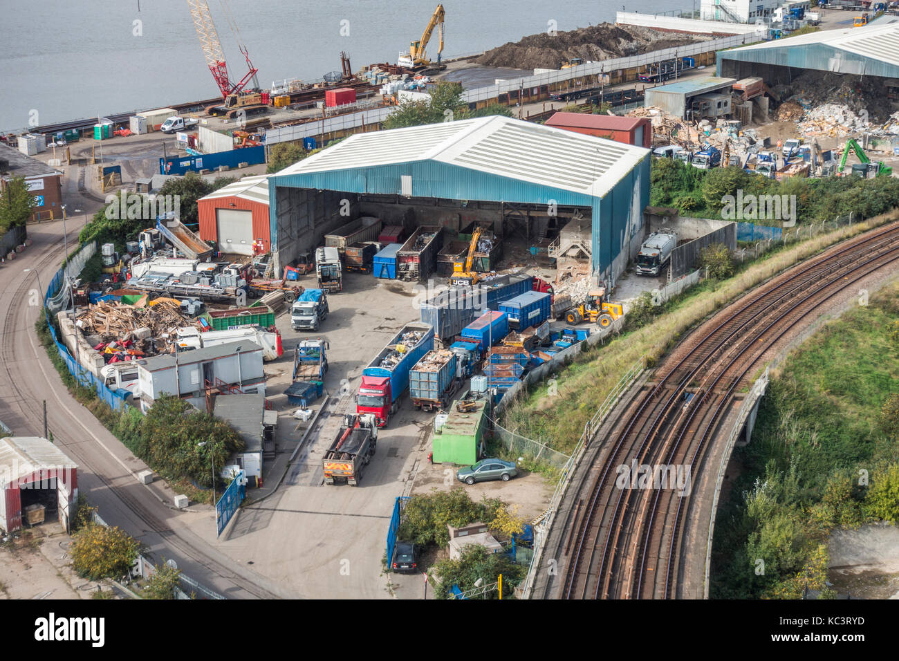 Next to the River Thames, an overhead shot of the premises of Docklands Waste Recycling Limited, Thames Wharf, SE - Stock Image