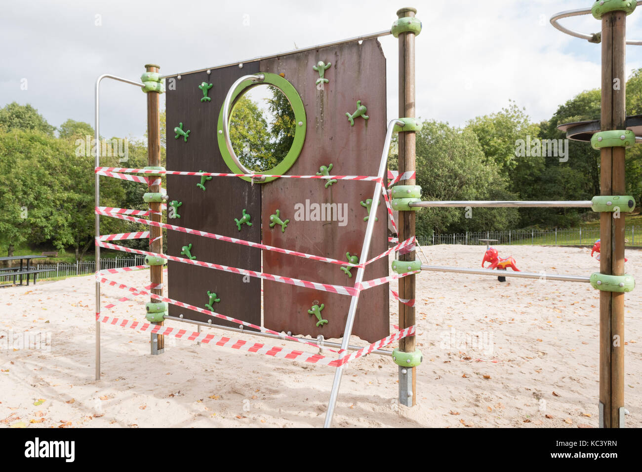 taped off broken unsafe play equipment - Stock Image