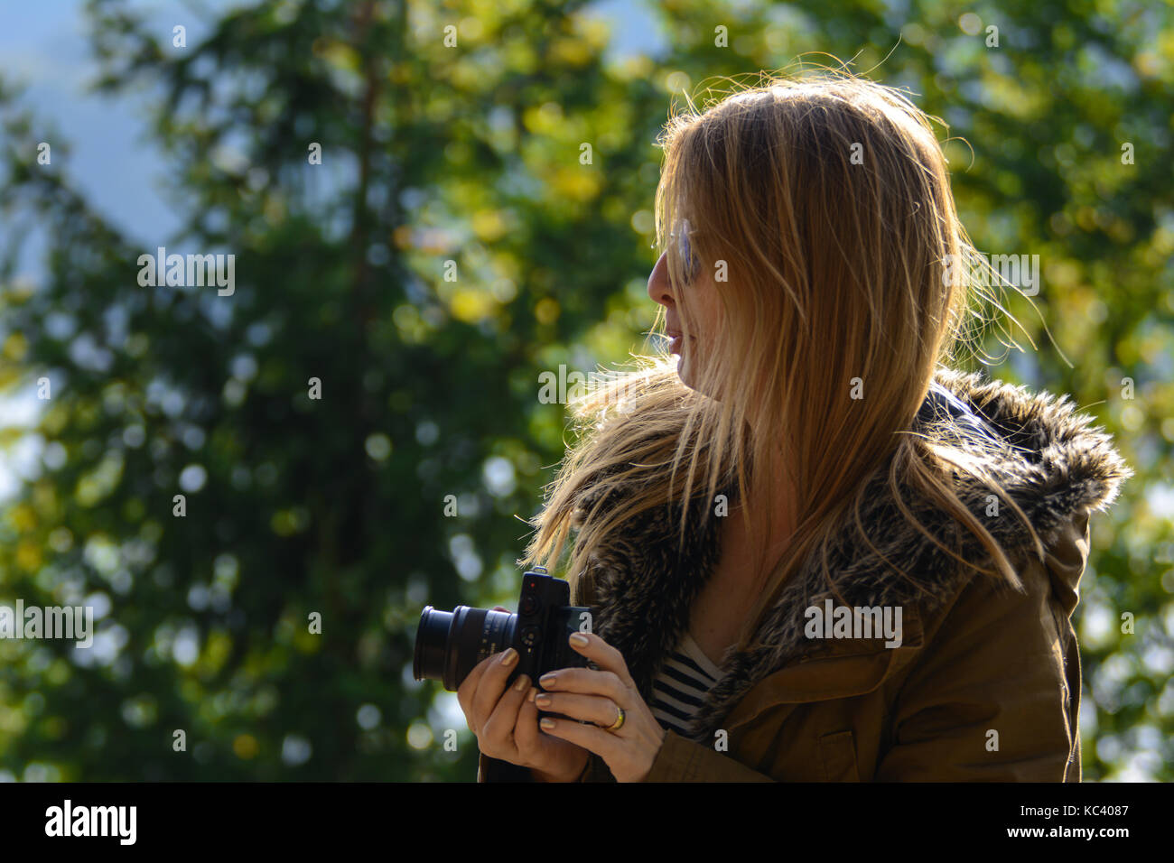 20 September 2017-Arges, Romania. Young, female blogger testing out a new Canon camera for a review - Stock Image