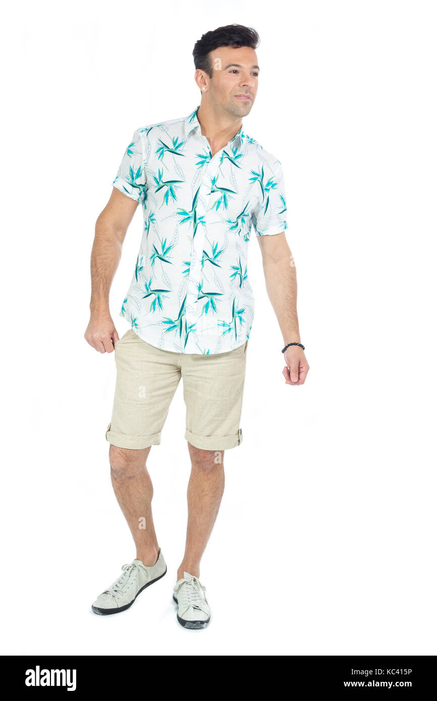 Brazilian male wearing a Hawaiian style floral shirt and beige shorts. Summer, tropical. - Stock Image