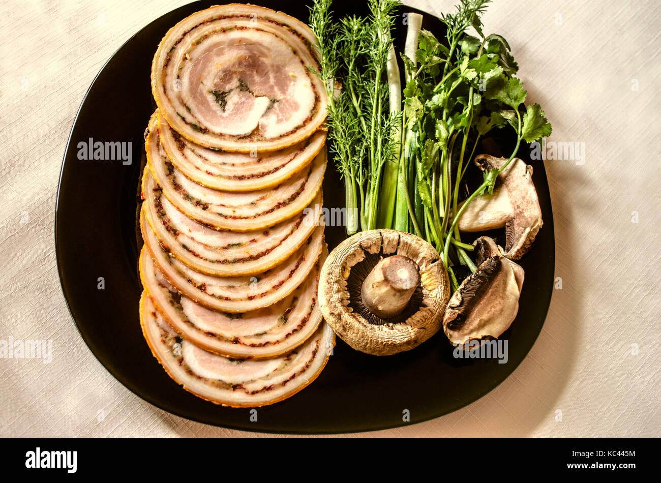 Sliced meatloaf with acute seasonings of smoked pork tenderloin Stock Photo