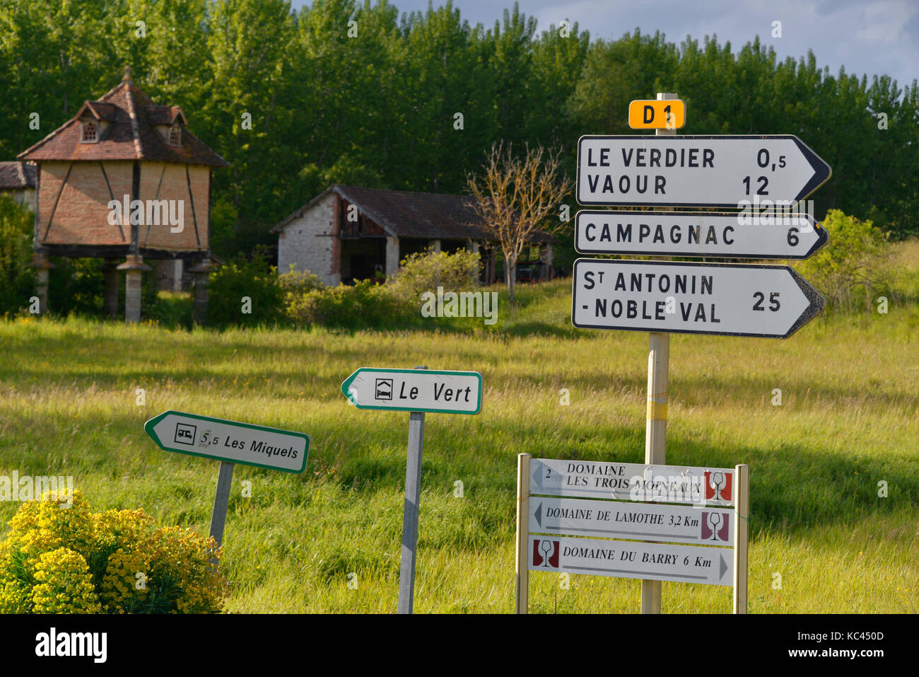 French road signs in front of the Le Verdier pigeonnier, the Tarn ...