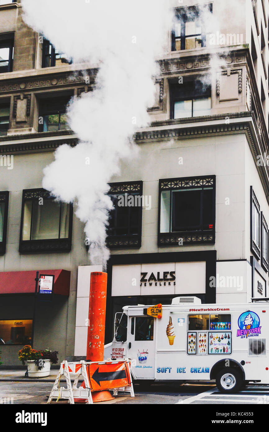 NEW YORK, NY - September 9th, 2017: steam vent and ice-cream truck on the streets of Manhattan - Stock Image