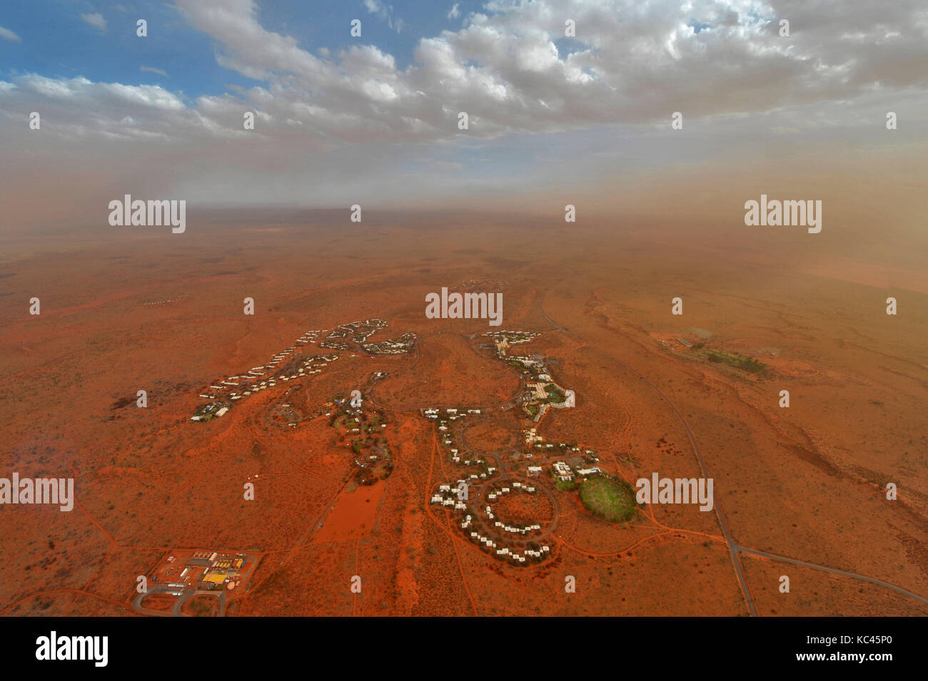 Aerial view of the village of Yulara at Uluru (Ayres Rock) in Australia's Northern Territory, at sunset. - Stock Image