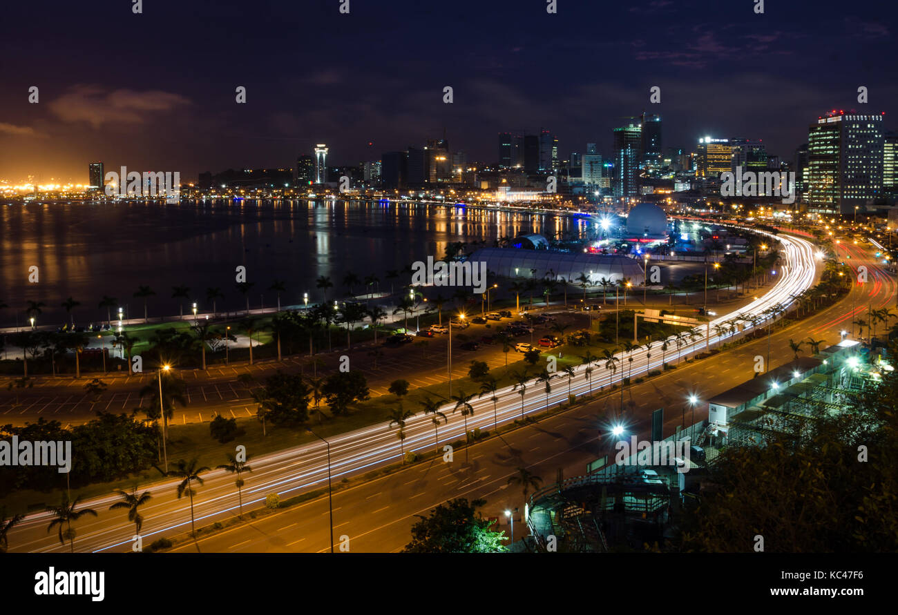 Skyline of capital city Luanda and its seaside during the night, Angola, Africa - Stock Image