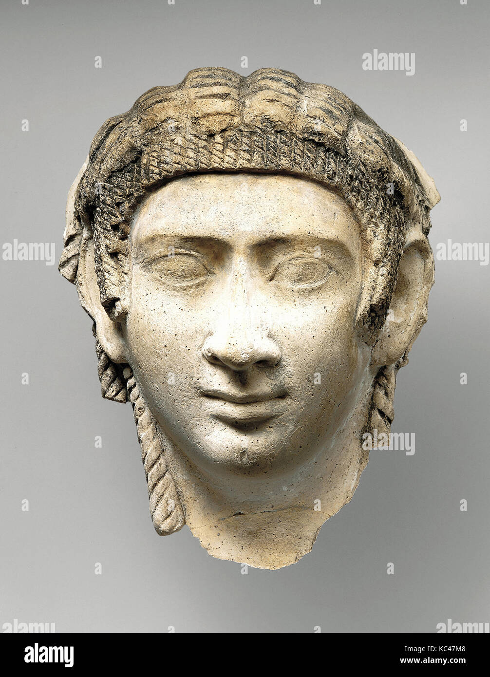 Mask of a woman with corkscrew locks and bang, A.D. 50–150 - Stock Image