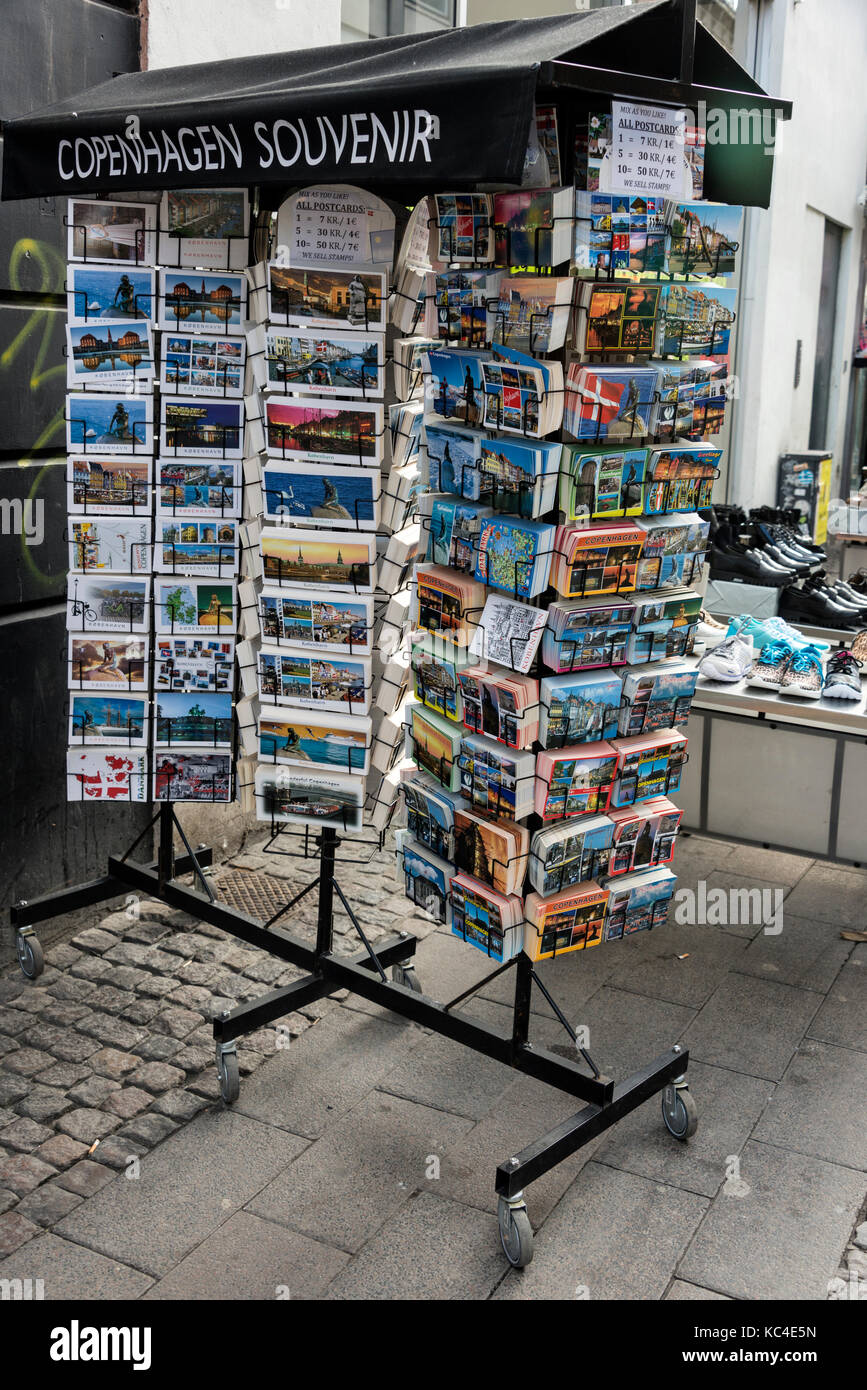 A rack of postcards on sale at one of the many Danish souvenir shops in Copenhagen, Denmark - Stock Image