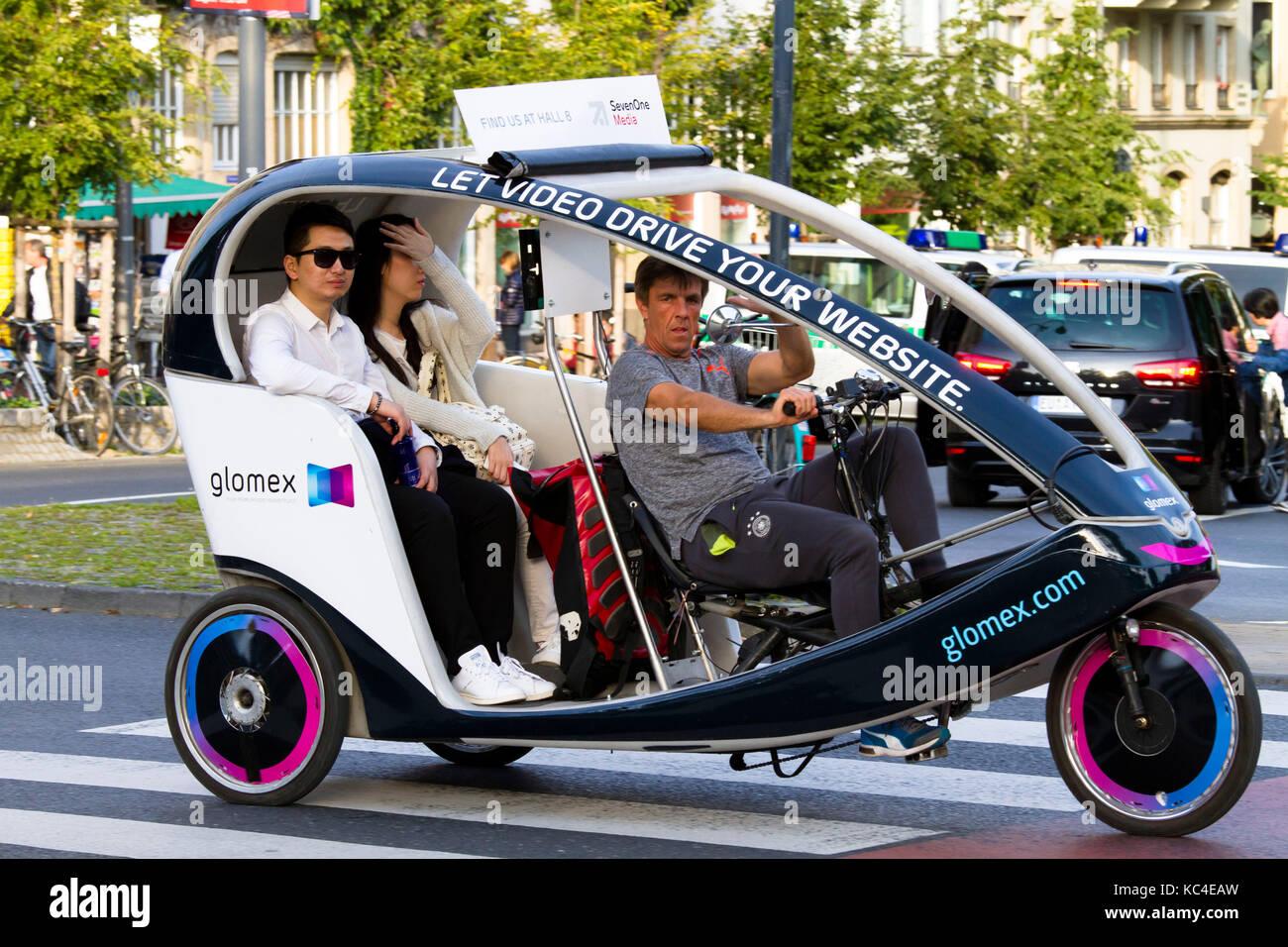 Germany, Cologne, rickshaw for sightseeing at the Heumarkt  Deutschland, Koeln, Fahrrad-Rikscha fuer Stadtrundfahrten Stock Photo