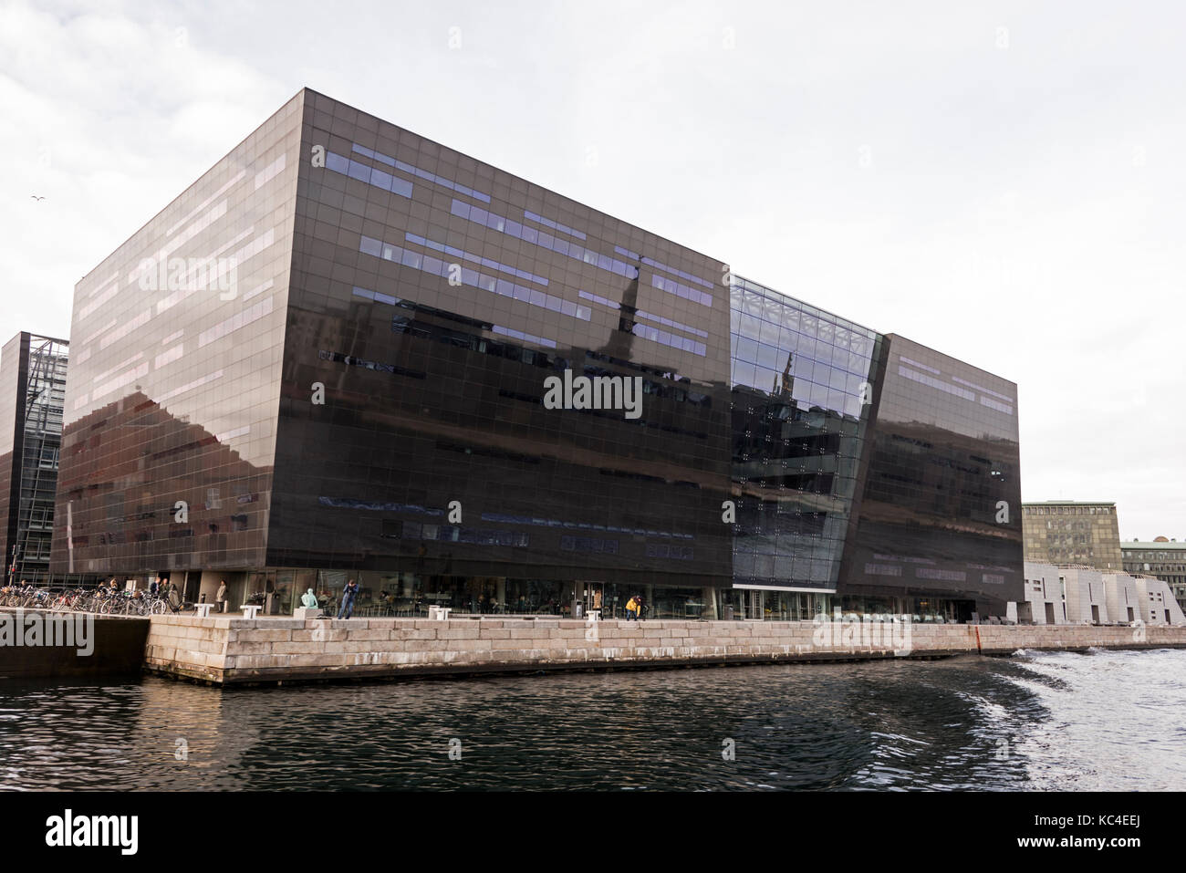 The modern diamond shaped library called the Black Diamond is a waterfront extension to the Royal Danish Library's Stock Photo