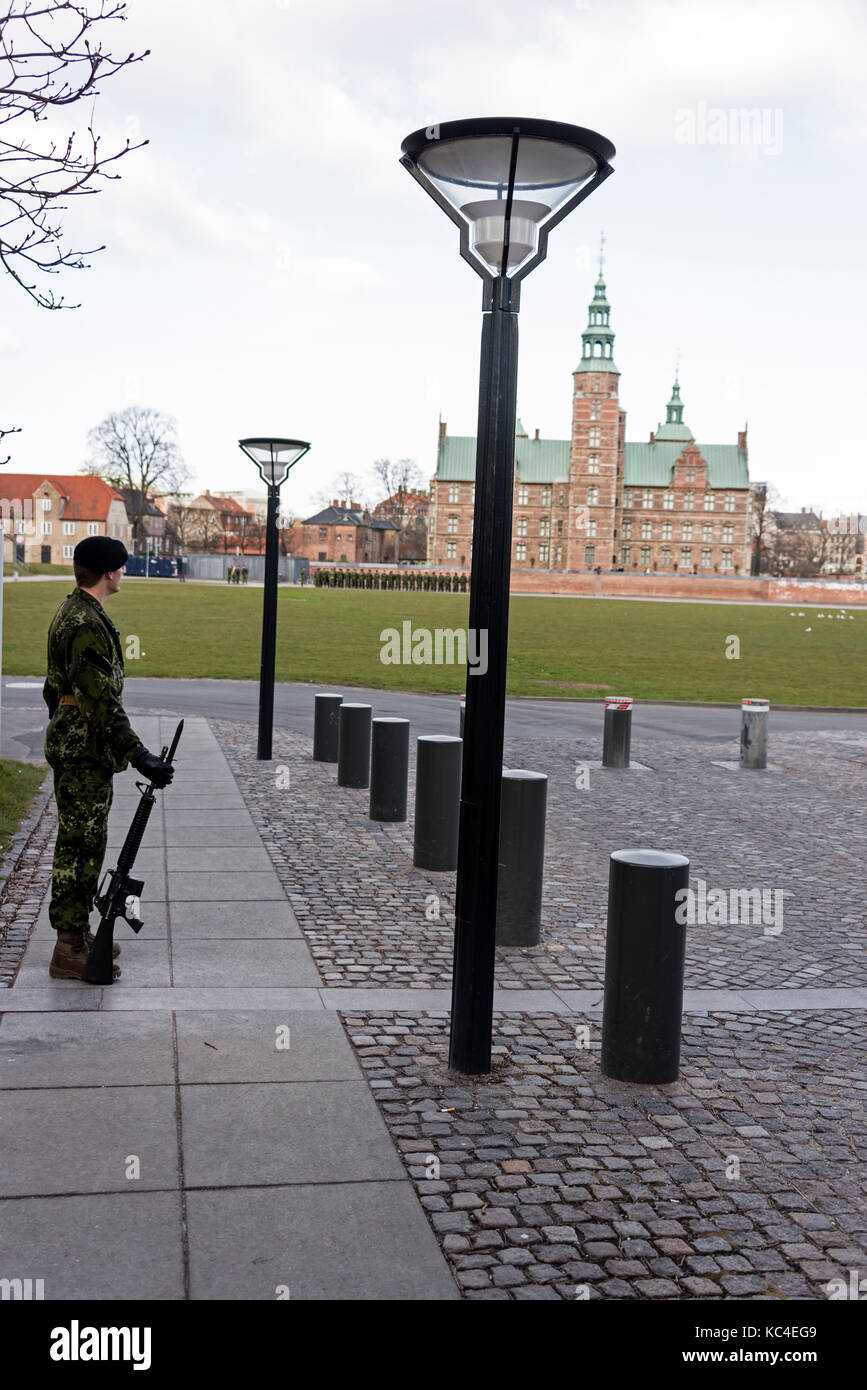 Sentry duty at one of the the main gates to the Rosenburg Castle in Copenhagen, Denmark. The castle holds the Crown Stock Photo
