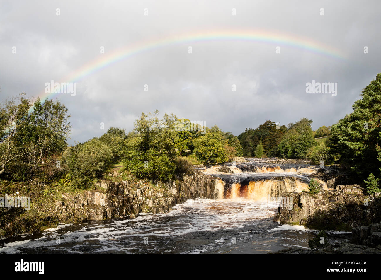 Low Force, Teesdale, County Durham, UK. 2nd Oct, 2017.  UK Weather.  A beautiful rainbow forms over Low Force waterfall Stock Photo
