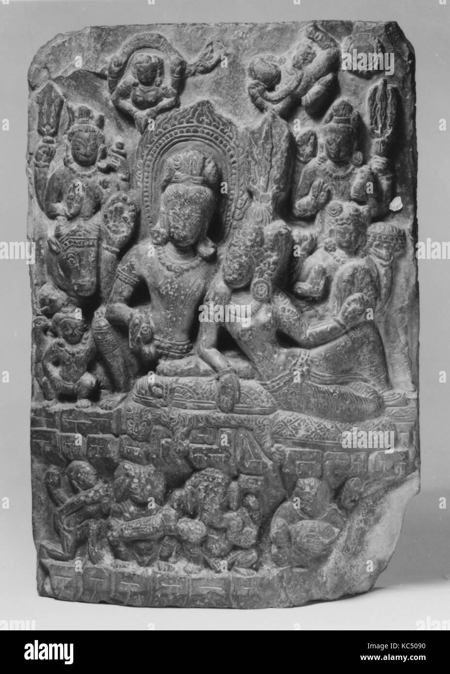 Shiva Seated with Parvati, ca. 10th century, Nepal (Kathmandu Valley), Stone, H. 12 3/8 in. (31.4 cm); W. 8 1/4 - Stock Image