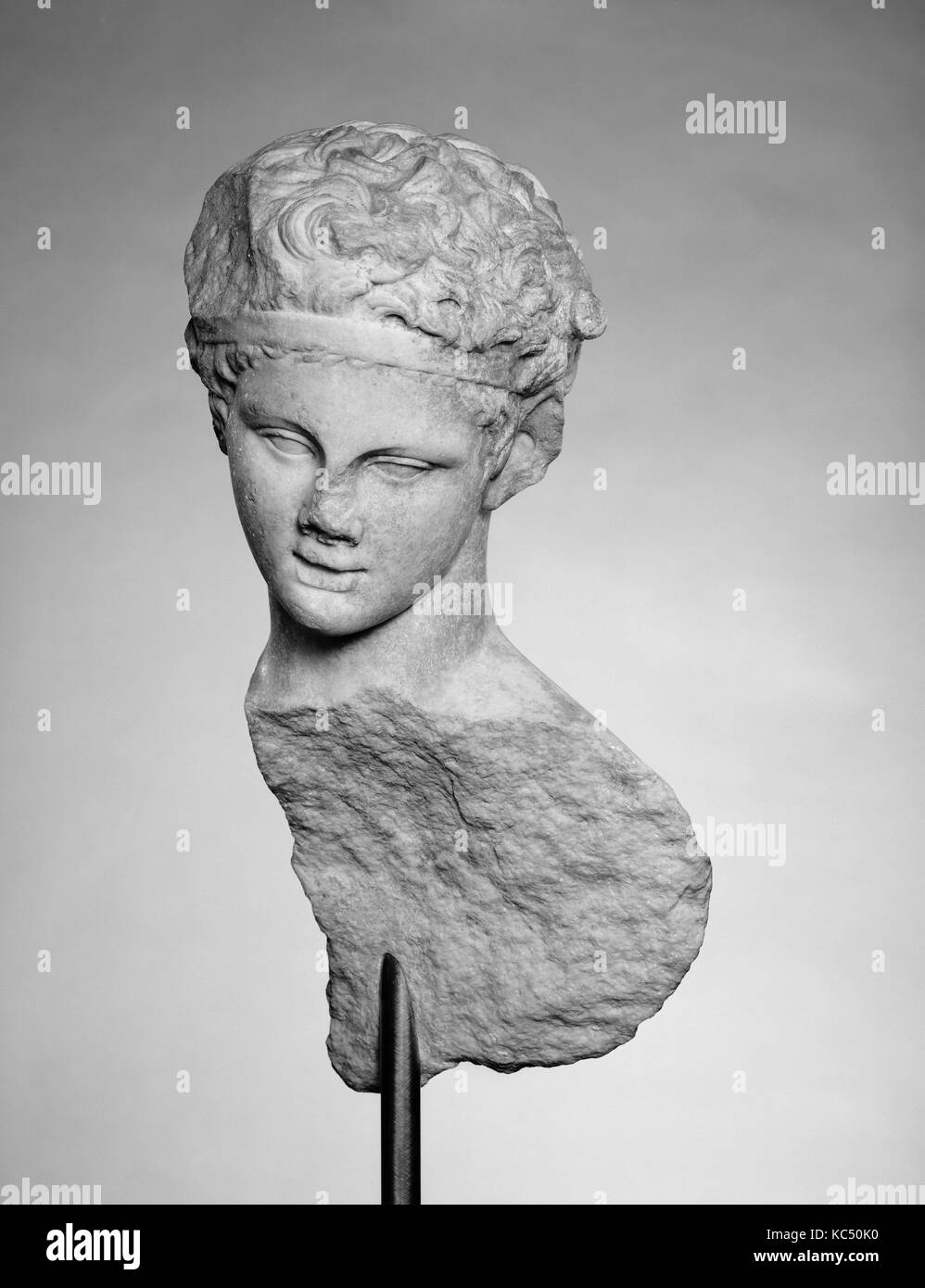 Head and part of the back of a marble statue, 1st or 2nd century A.D Stock Photo