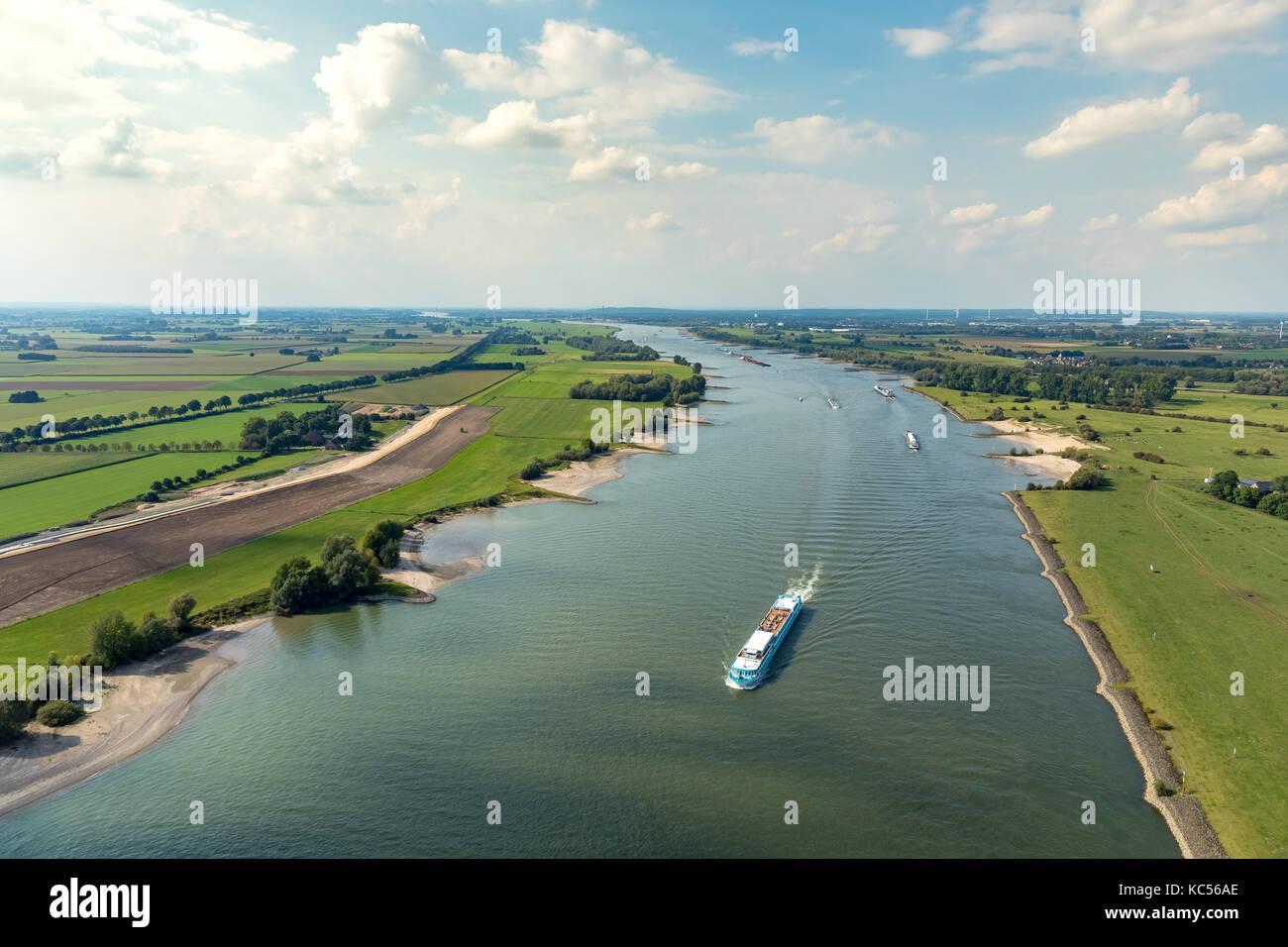 Rhine near Emmerich with cargo ships, inland navigation, Rhine landscape, Emmerich, Lower Rhine, North Rhine-Westphalia, Stock Photo