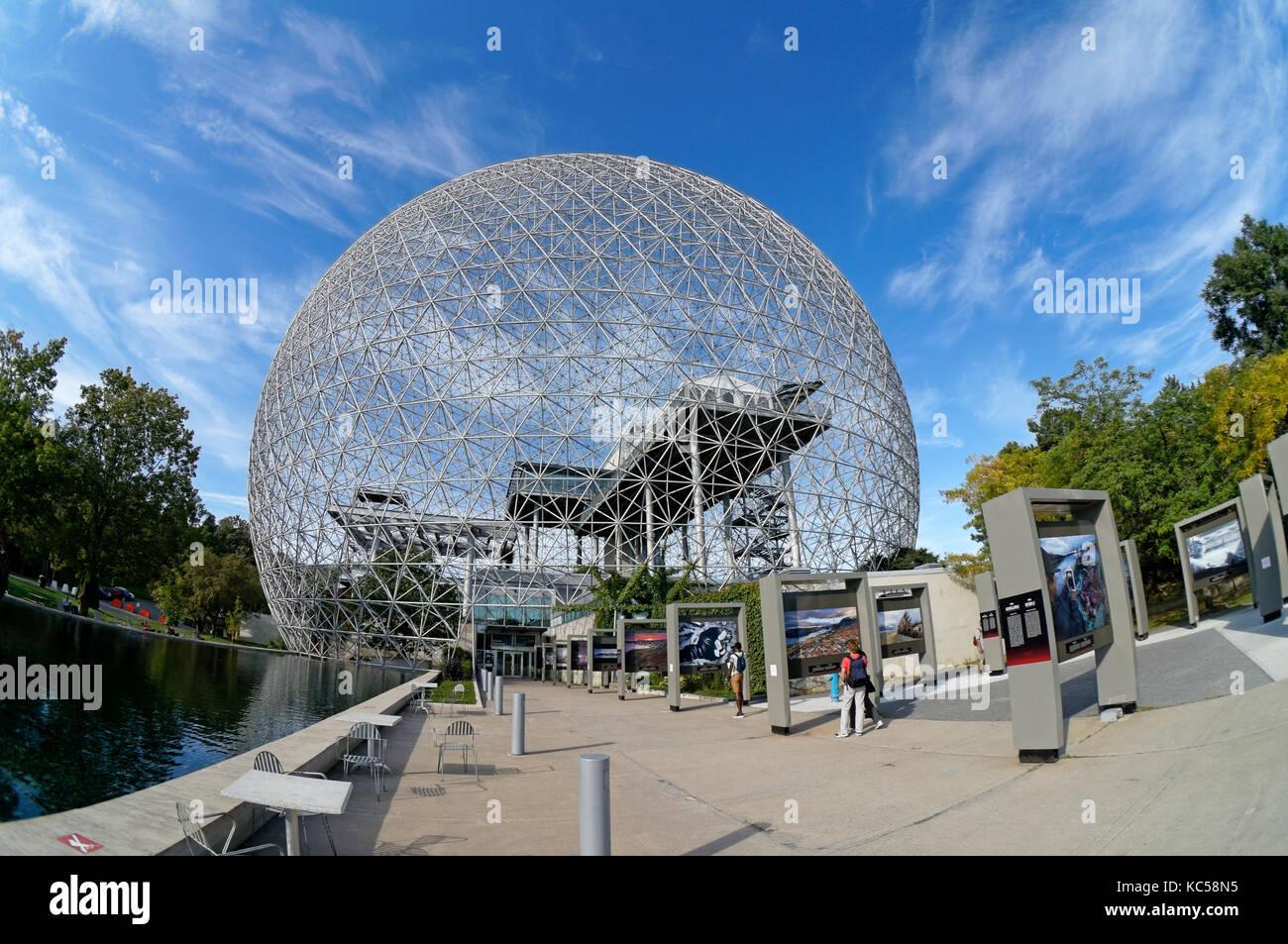 Tourists outside the Montreal Biosphere in Parc Jean Drapeau, Ile Sainte-Helene, Montreal, Quebec, Canada - Stock Image
