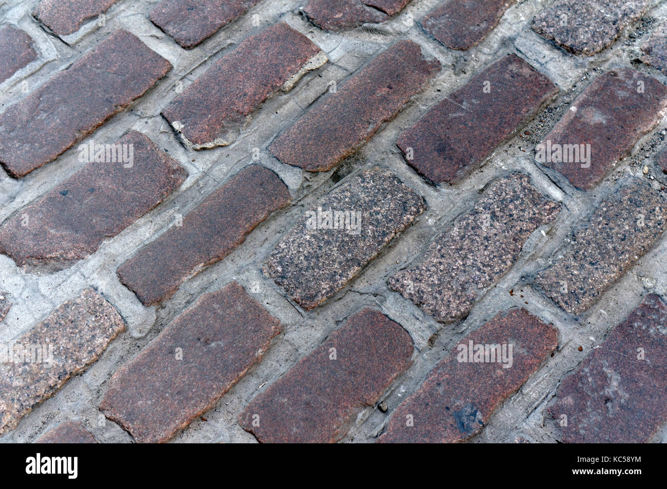 Close-up of rectangular cobblestones (setts) on a cobblestone street in Old Montreal, Quebec, Canada - Stock Image