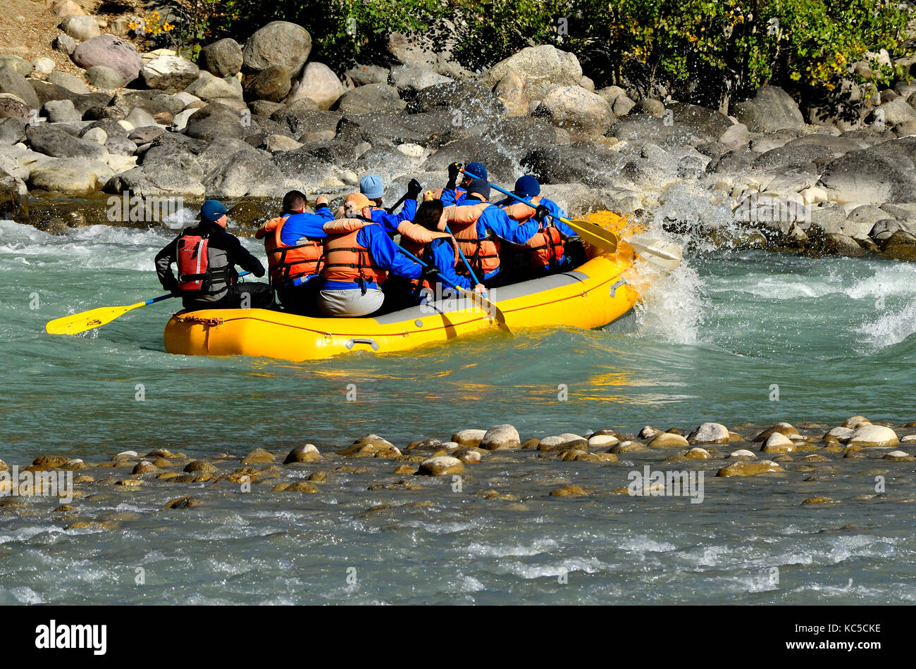 A group of tourists river rafting on the Athabasca River in Jasper National Park, Alberta Canada. - Stock Image