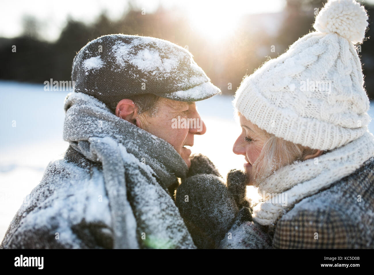 Beautiful senior couple on a walk in sunny winter nature Stock Photo