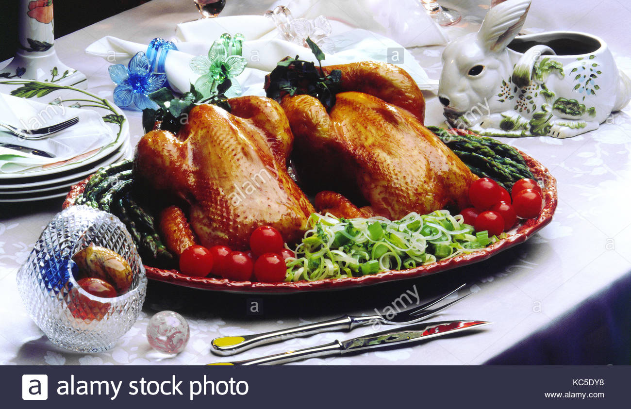 EASTER TABLE SETTING ROAST CHICKENS - Stock Image