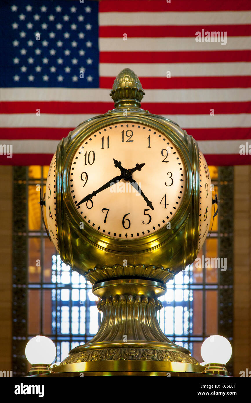 Brass clock inside Grand Central Terminal, New York City, USA - Stock Image