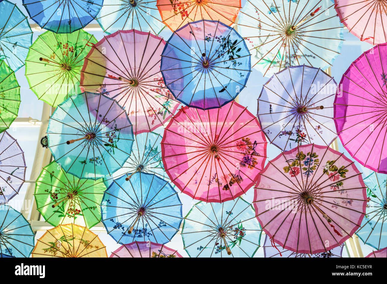 Roof decorated by colorful handmade umbrellas made from paper for protecting sunlight from outside. - Stock Image