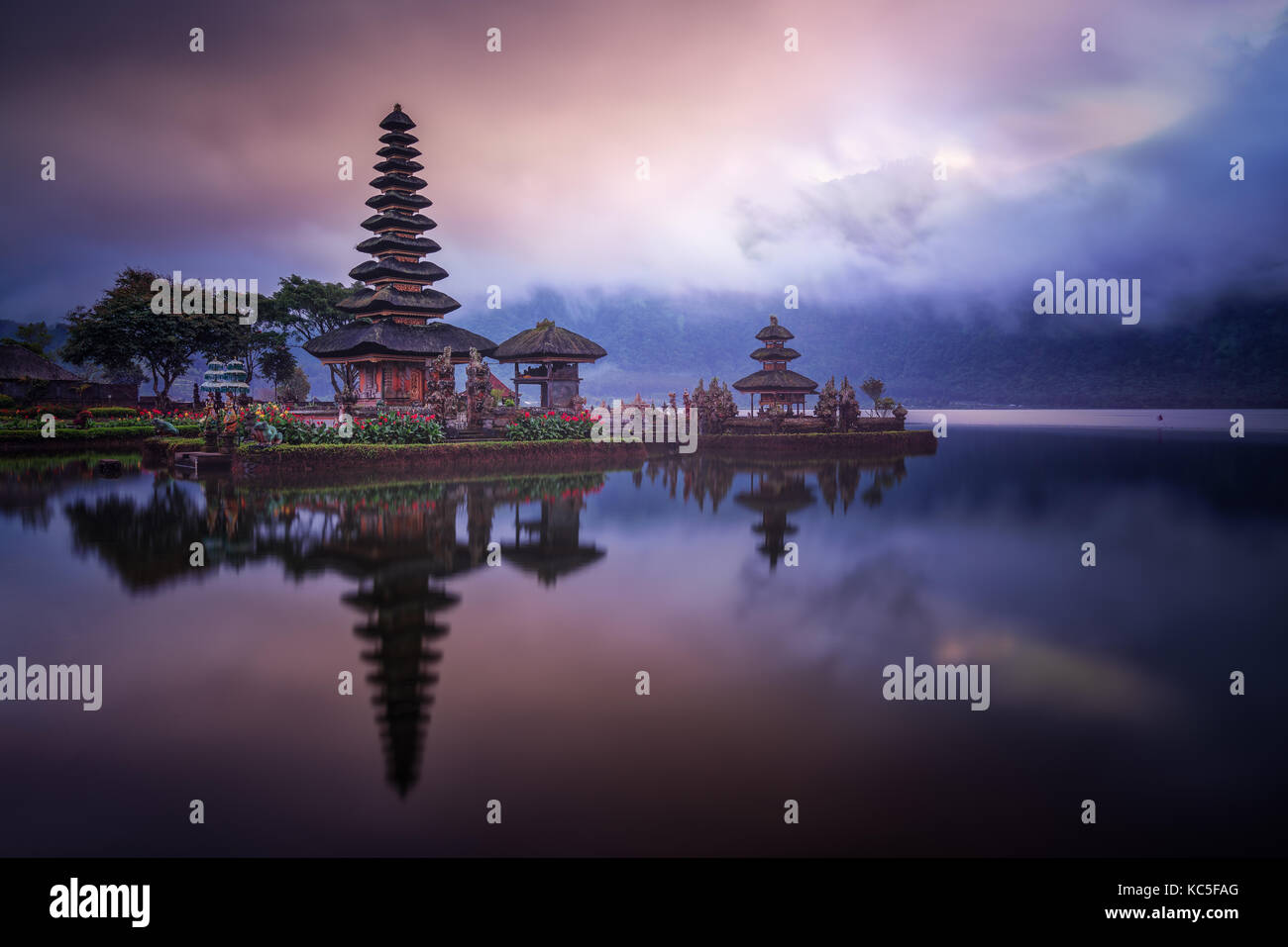 Cloudy sunrise  in the Hindu water temple Ulun Danu Bratan also known as Pura Bratan, in the Indonesian island of - Stock Image