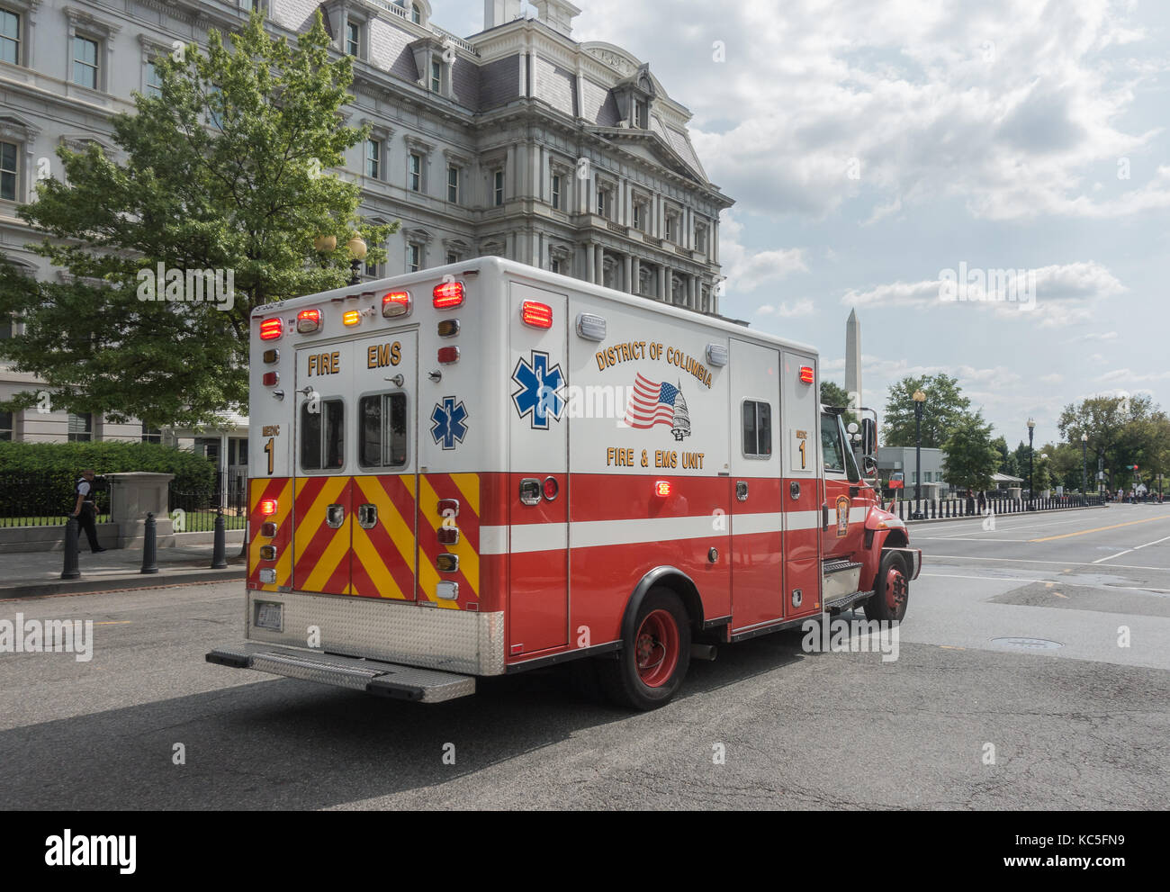 EMS ambulance responding, Washington Monument and Executive Office Building background. EMS is part of fire department - Stock Image