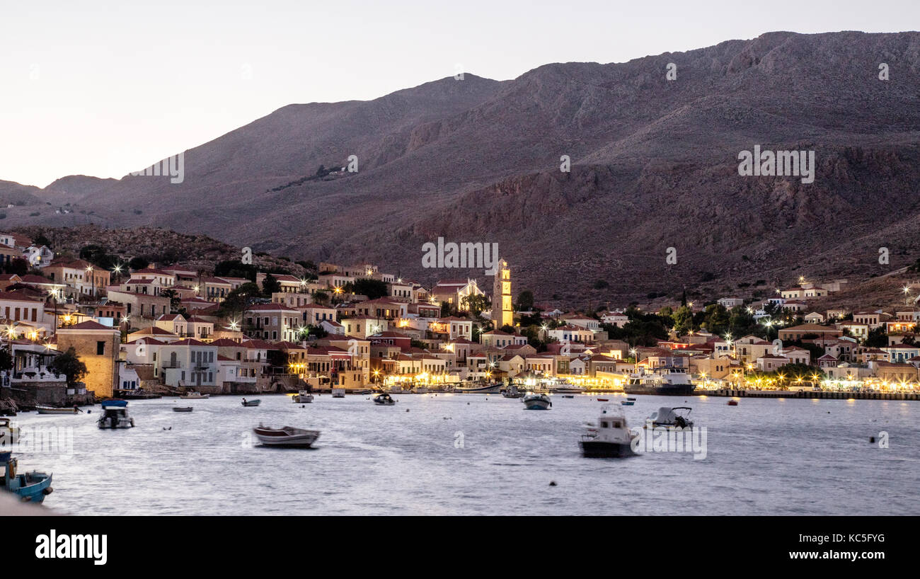 The Town and Harbour Halki Greek Islands Greece - Stock Image