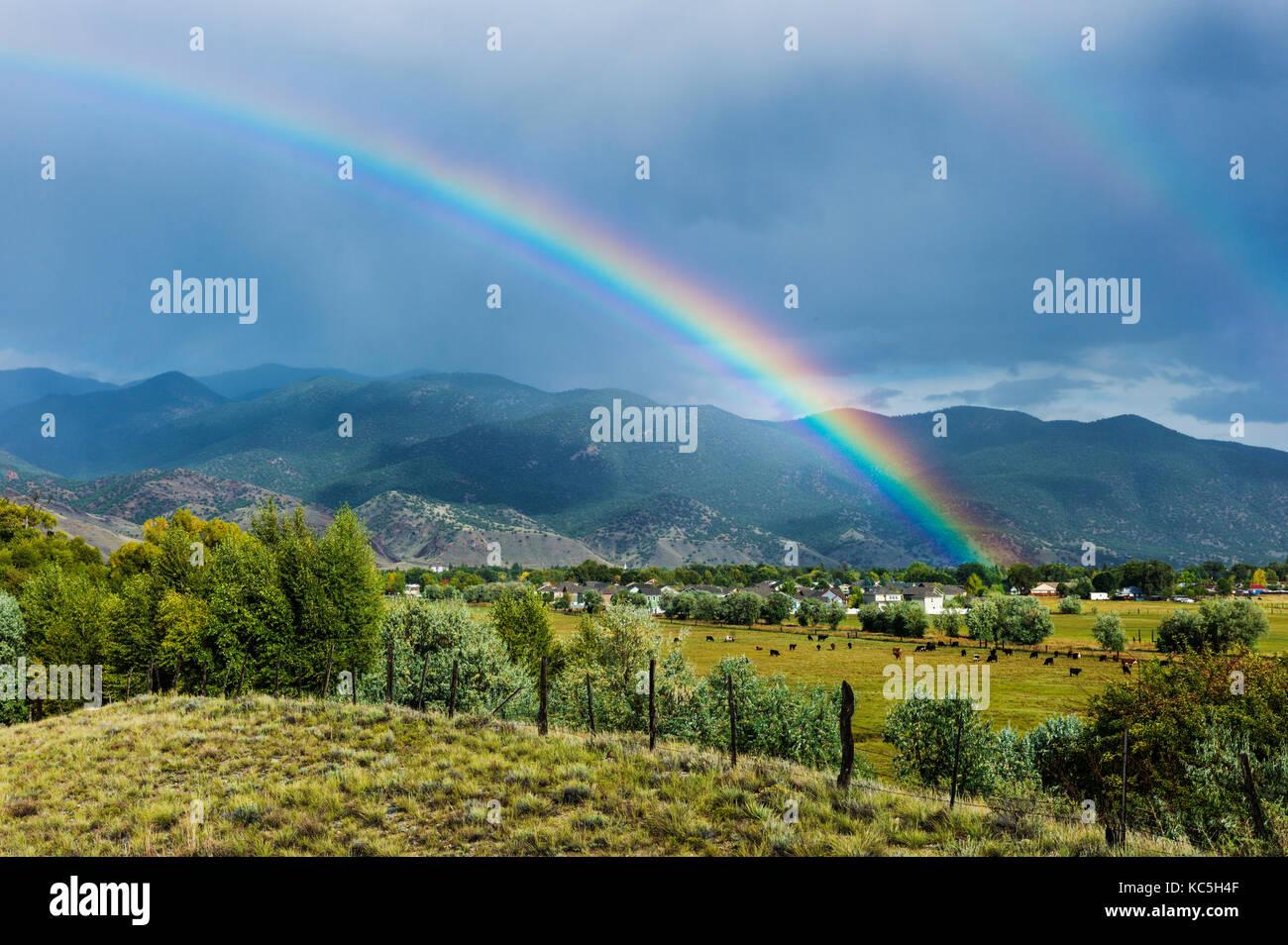 Rainbow over the small mountain town of Salida, Colorado, USA Stock Photo