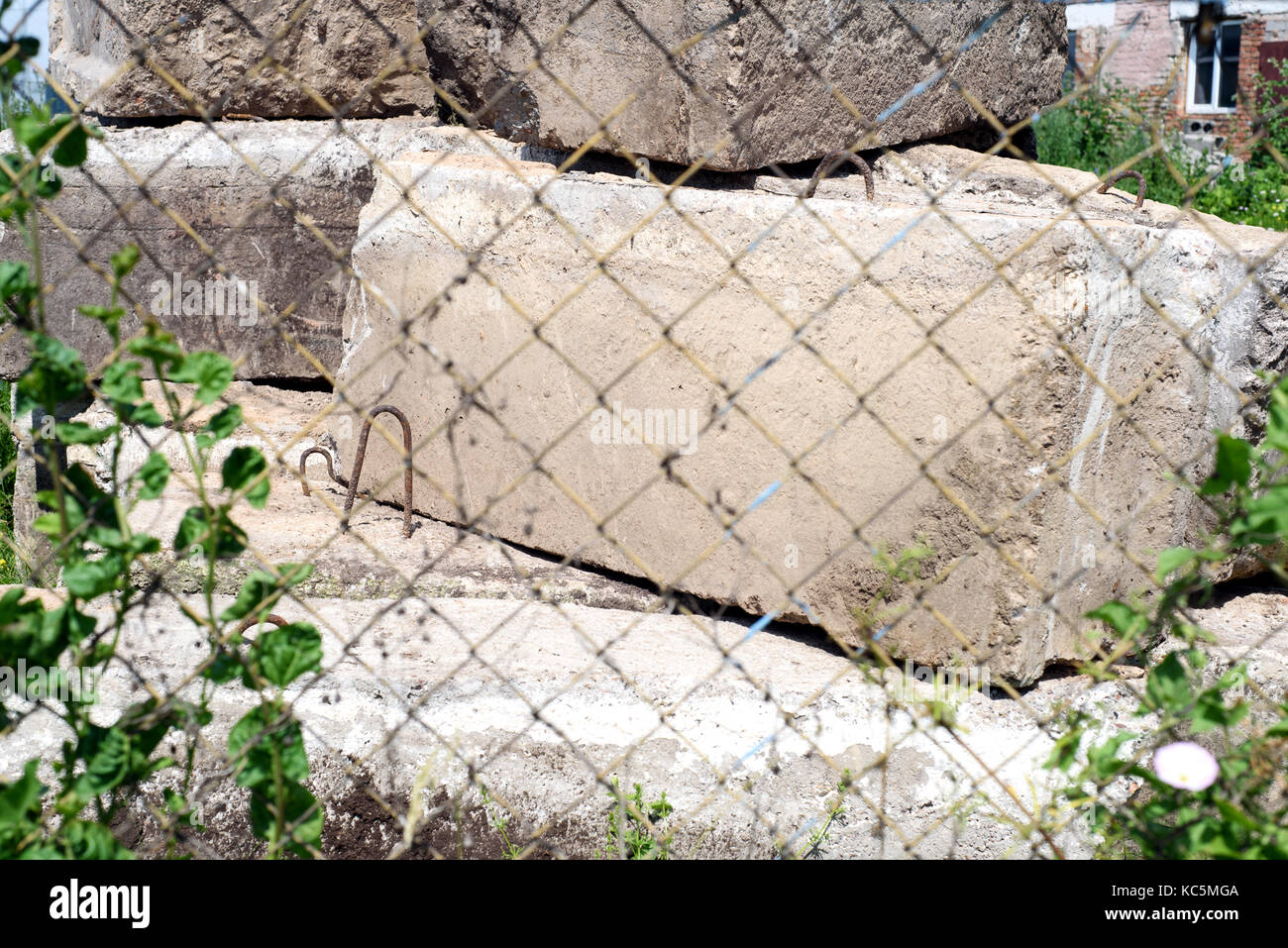 Old concrete blocks used as blockades and in construction