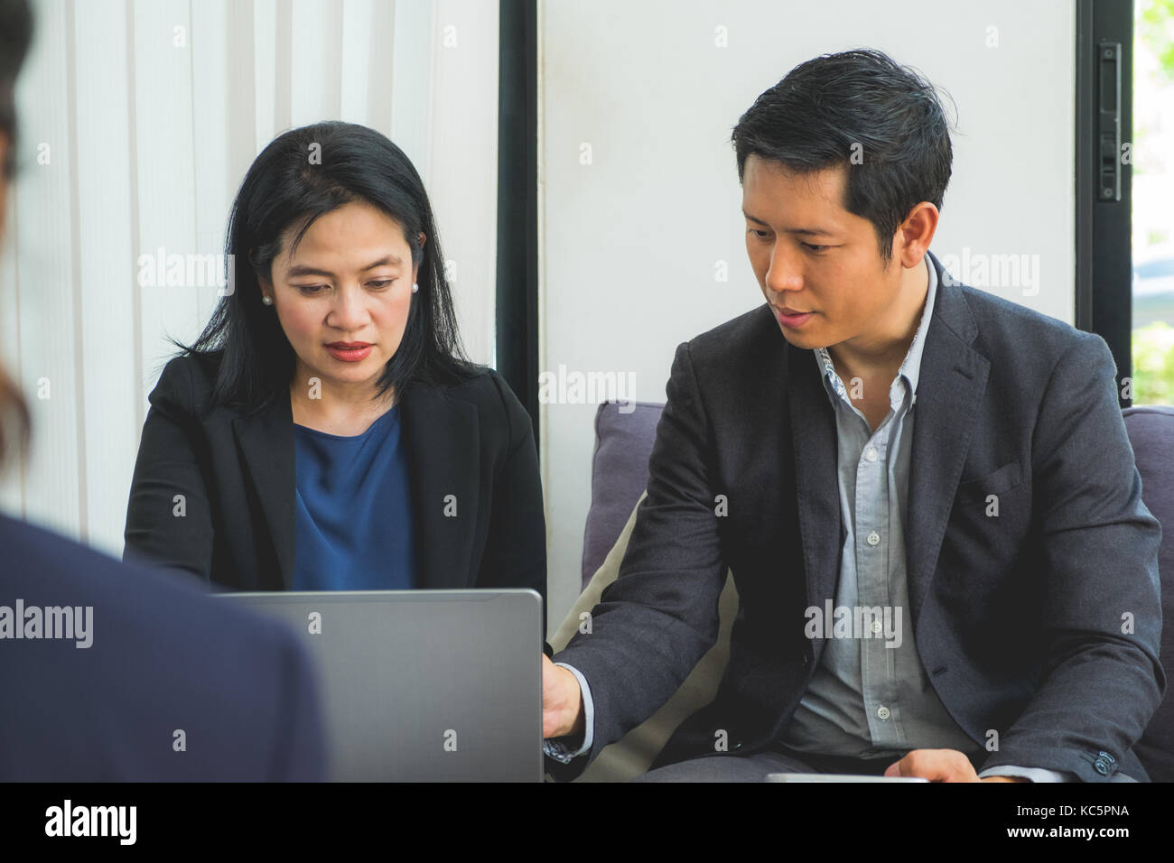 Business woman and man planing work at corporate meeting in office,Business conference concept. - Stock Image