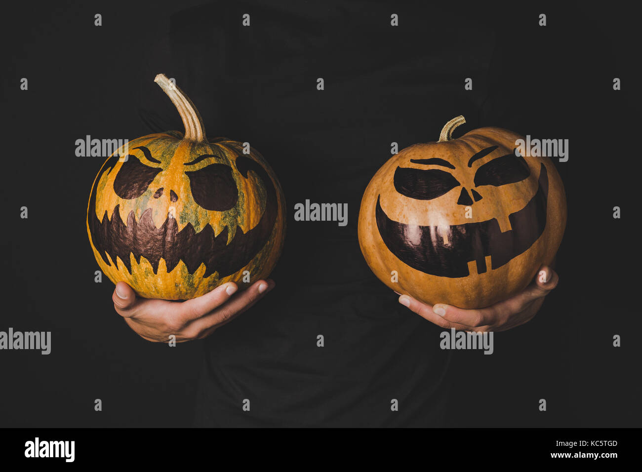 man with pumpkins in hands - Stock Image