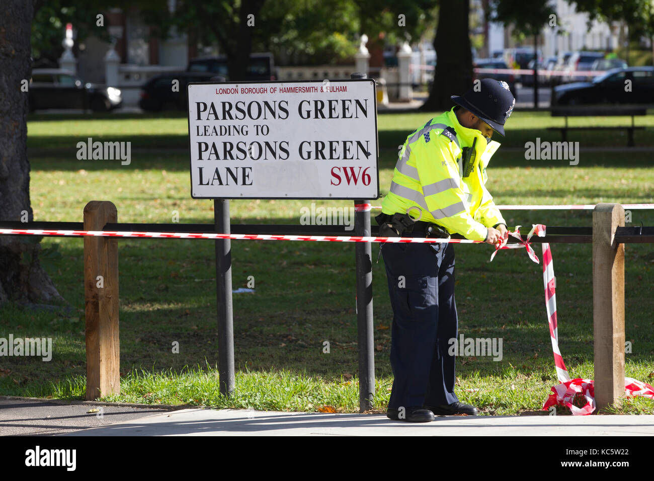 Emergency services attend the area nearby to Parsons Green underground station where an explosive device was planted - Stock Image