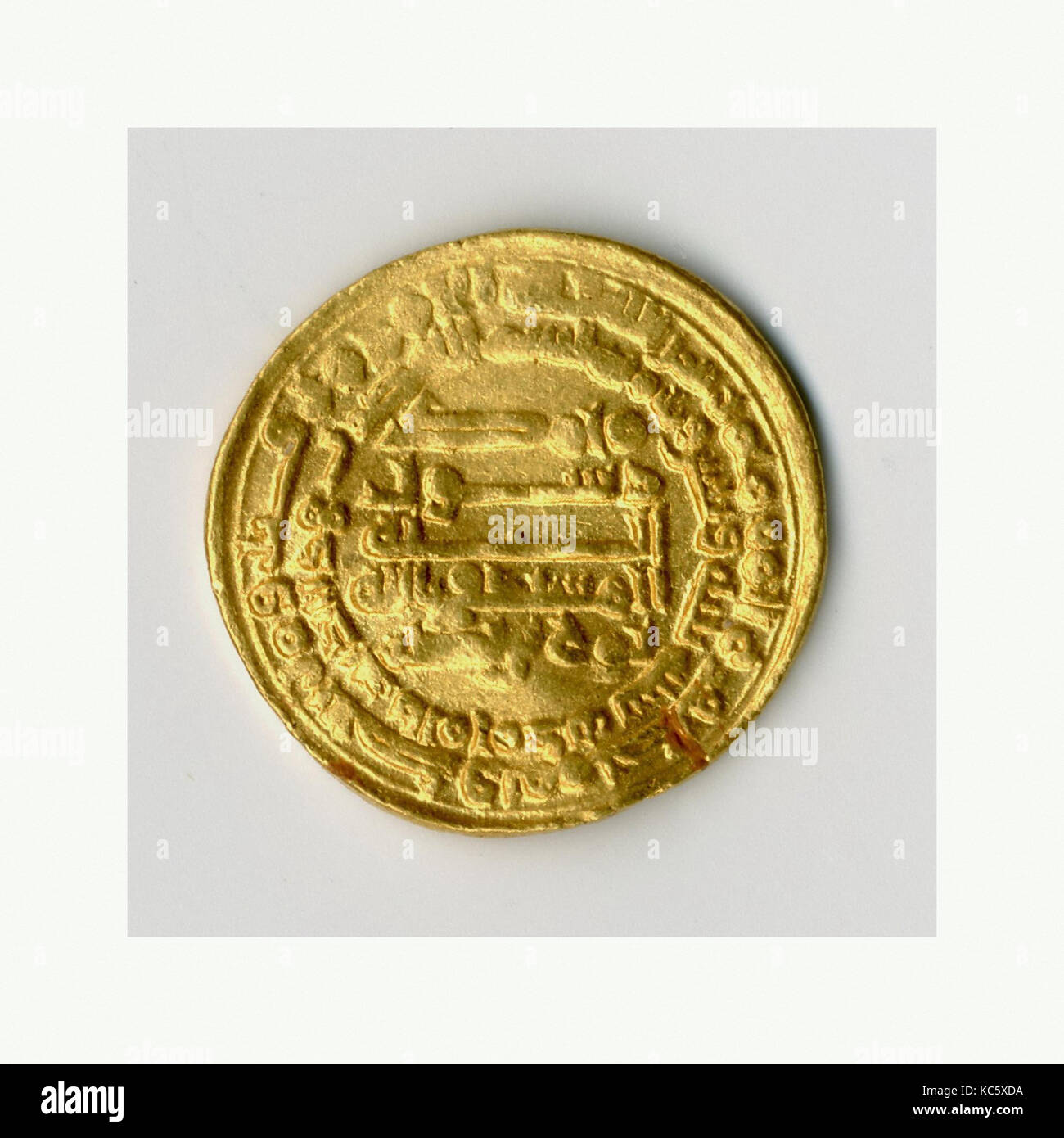 Coin, A.H. 333/A.D. 944, Excavated in Iran, Nishapur. Mint Iran, al-Muhammadiyya, Gold, Diam. 3/4 in. (1.9 cm), - Stock Image