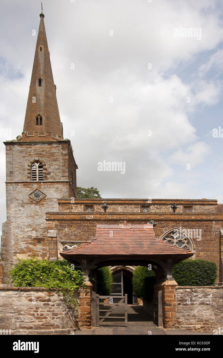 The grade I listed parish church of St Bartholomew which is of Saxon origin, last rebuilt in 1957, Greens Norton, - Stock Image