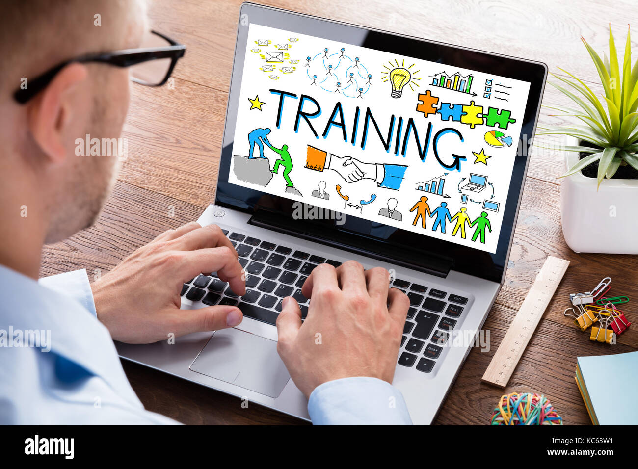 Business Person Working On A Training Concept On Laptop ...