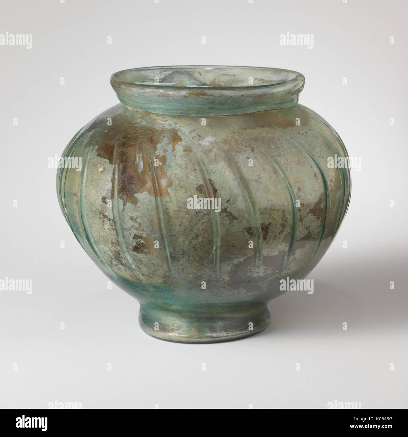 Glass jar, Early Imperial, 2nd half of 1st–mid-2nd century A.D., Roman, Glass; blown and tooled, H.: 5 15/16 in. - Stock Image