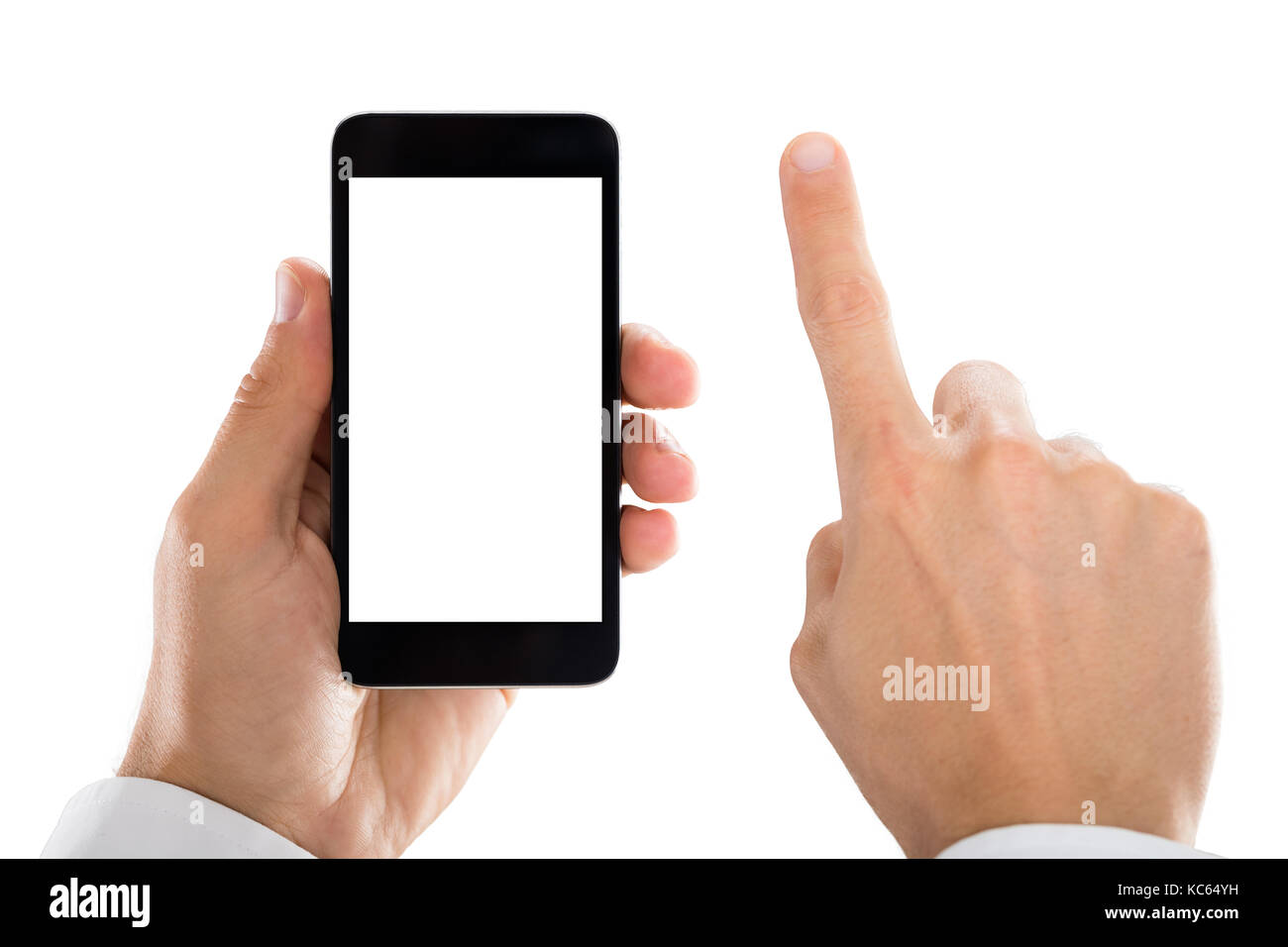 Close-up Of Man's Hand Holding Mobile Phone Against White Background - Stock Image