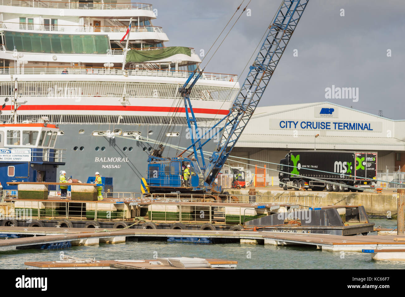 ABP staff working at City Cruise Terminal at Southampton docks/ port with the Balmoral cruise liner in the background - Stock Image