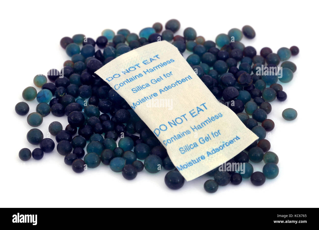 Silica gel  used as absorbent of moisture over white background Stock Photo