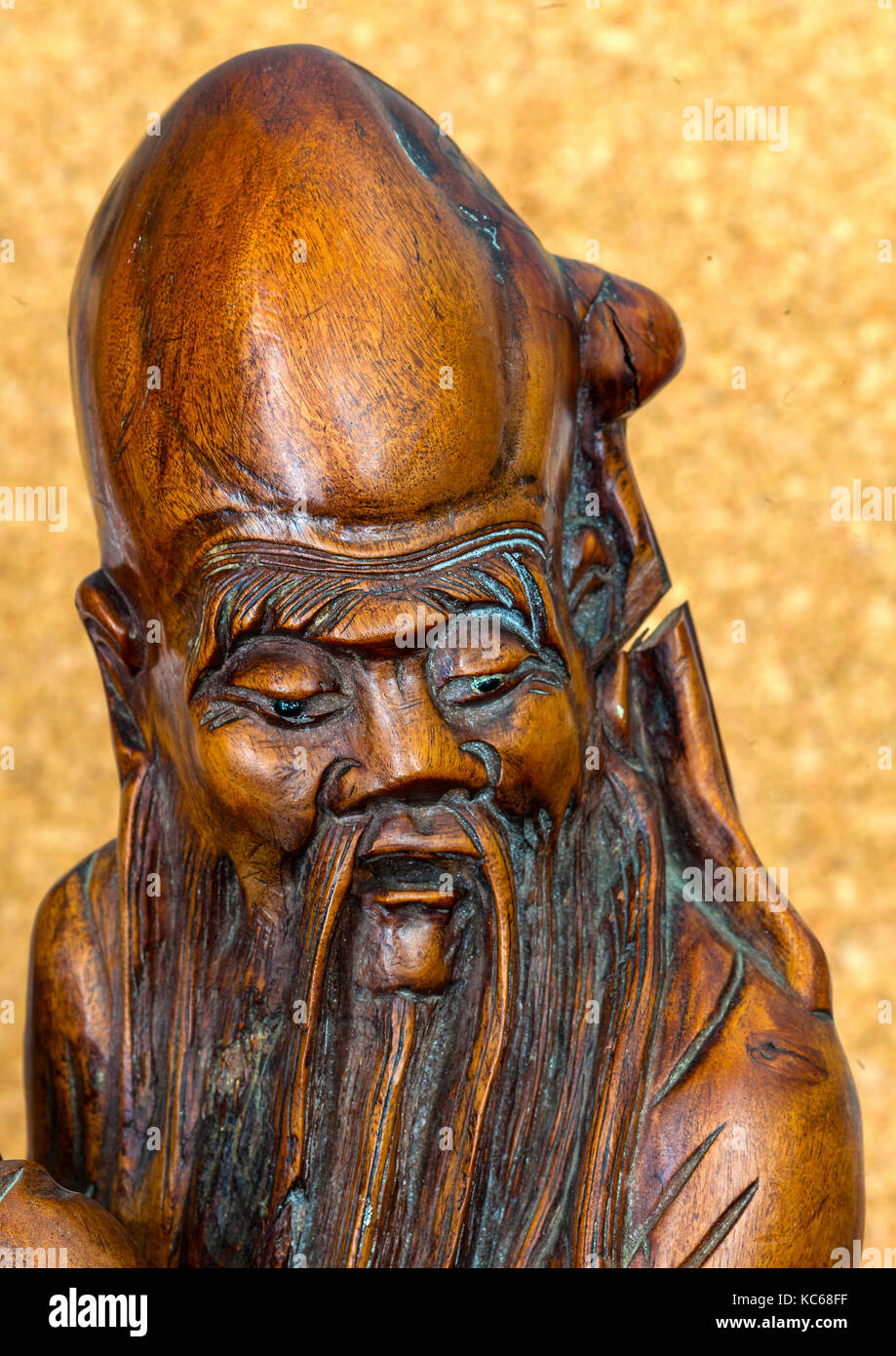 Antique statue of Chinese man with beard - Stock Image