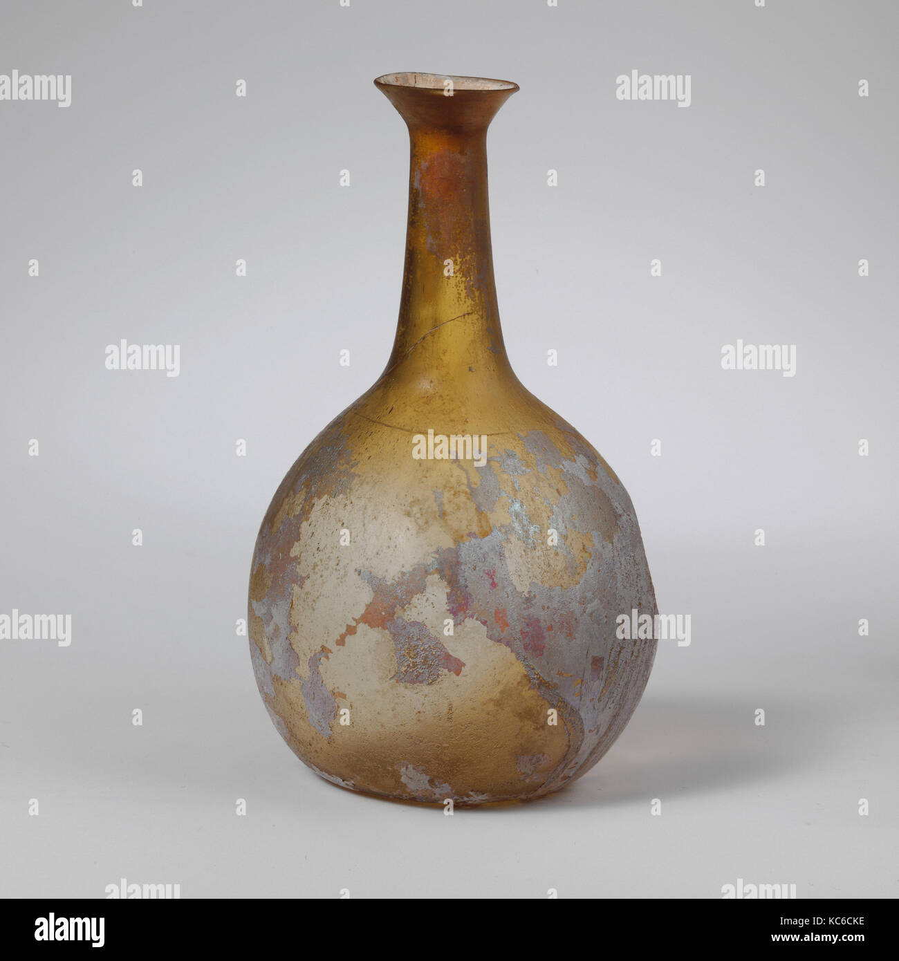 Glass perfume bottle, Early Imperial, 1st century A.D., Roman, Glass; blown, 4 11/16in. (11.8cm), Glass, Translucent - Stock Image