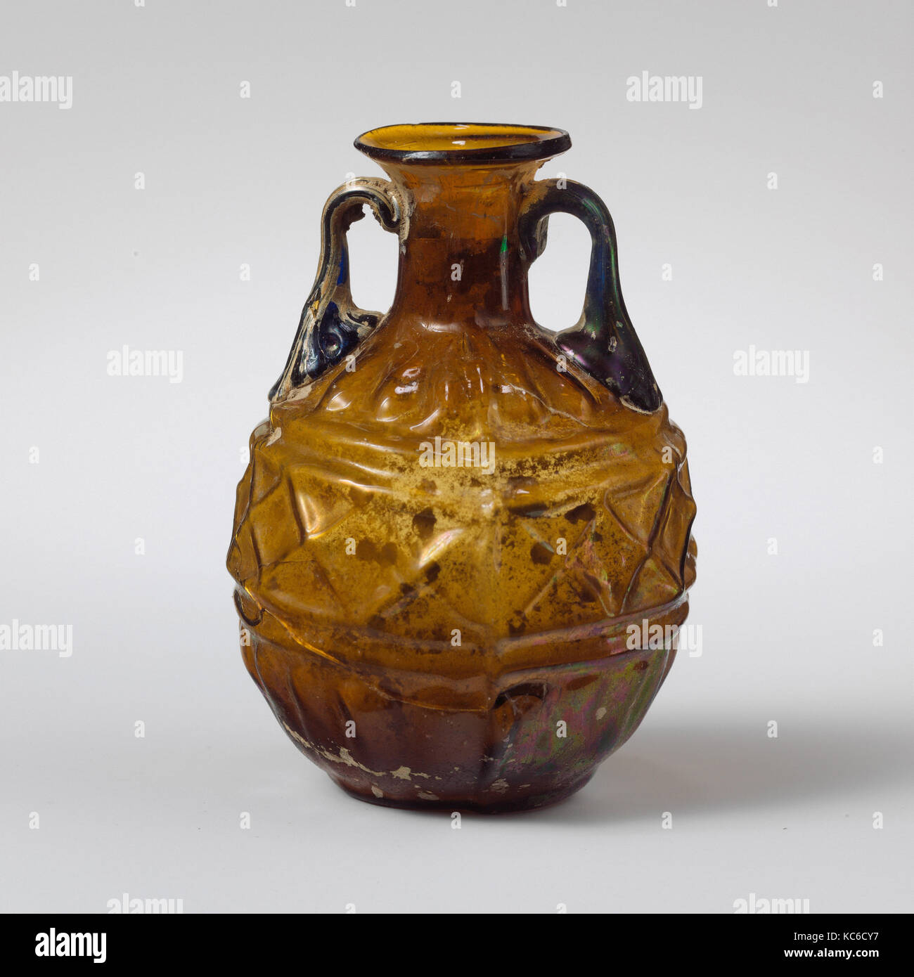 Glass amphoriskos (perfume flask) with band of lozenges, 1st century A.D - Stock Image