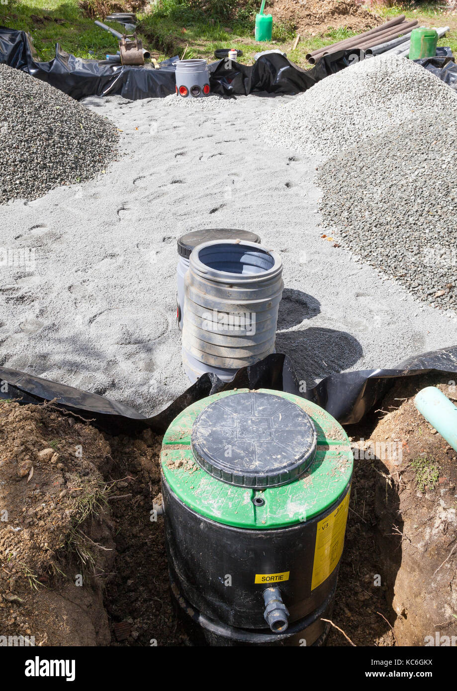 Close up on the pump, filters and sand and gravel filter bed for a ...