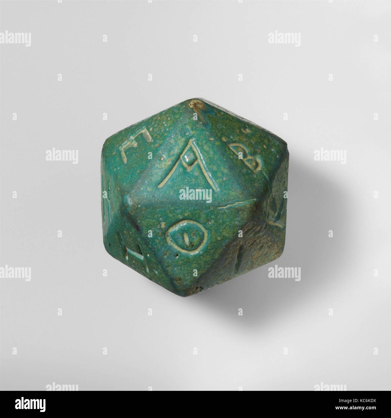 Faience polyhedron inscribed with letters of the Greek alphabet, 2nd–3rd century A.D - Stock Image