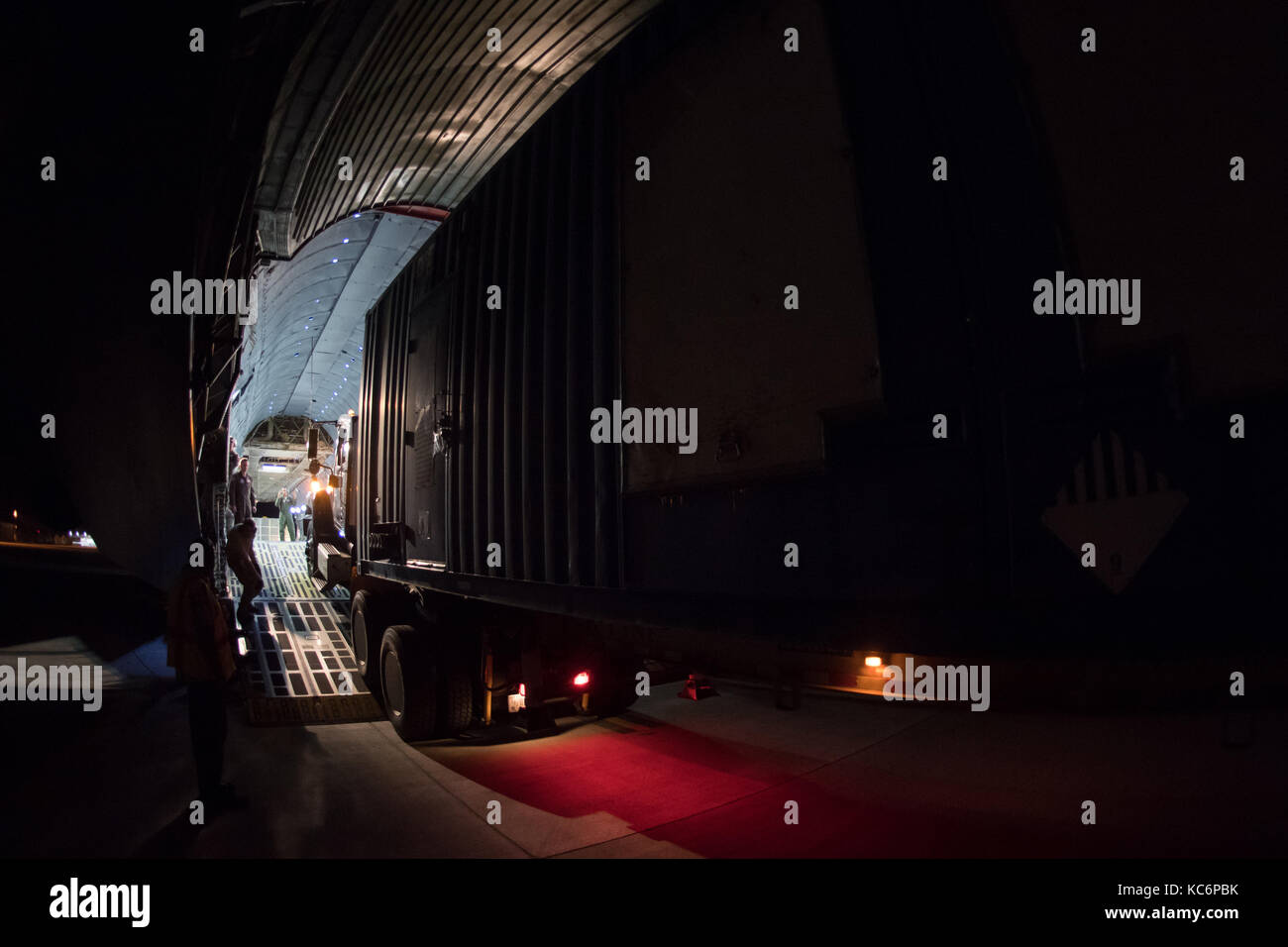 Loading 5,000-pound Federal Aviation Administration power generator on a C-5 Super Galaxy. - Stock Image