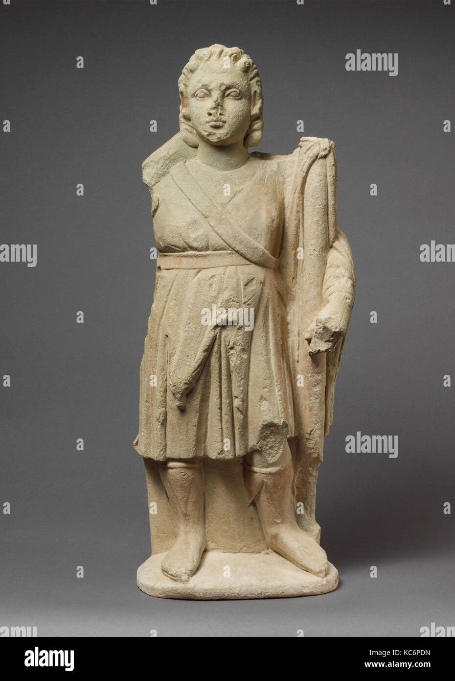 Limestone statuette of Dionysos holding a thyrsos, 310–30 B.C Stock Photo