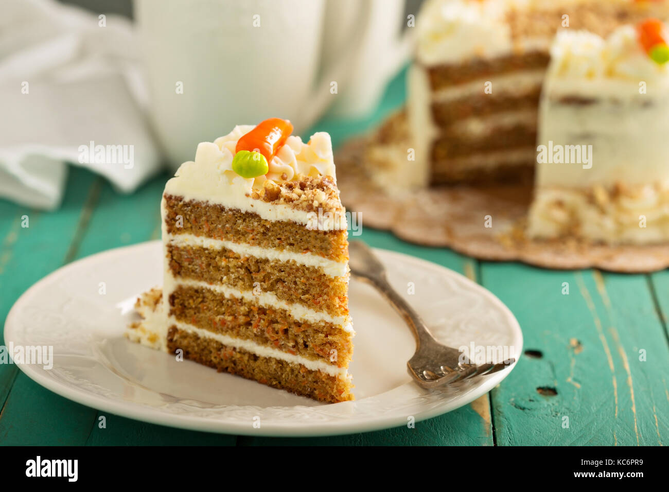 Piece of carrot cake with cream cheese frosting - Stock Image