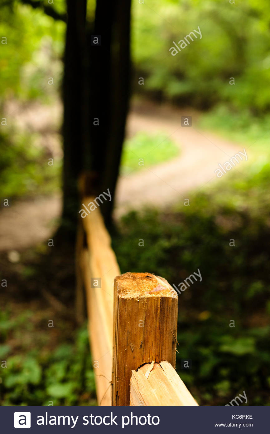 Fence post and hiking trail within the Pike Lake Unit, Kettle Moraine State Forest, Hartford, Wisconsin - Stock Image