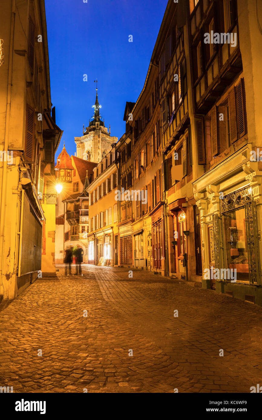 France, Grand Est, Colmar, Incidental people in long exposure with St Martin Church background - Stock Image